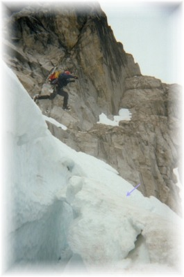 Jumping a crevasse on the Sherpa Glacier after climbing the Ice Cliff Glacier on Mt. Stuart